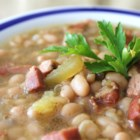 Ham and Beans and More - Great Northern beans are soaked, then cooked slowly with caramelized leeks, ham, and bacon to make a bean soup from scratch that's bursting with flavor.