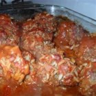Hedgehogs - Meatballs with rice in them, cooked in tomato soup. Serve with mashed potatoes and beans or on a bed of rice, if desired.