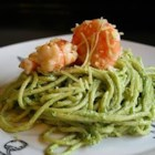 Creamy Pesto Shrimp - Butter, cream, Parmesan cheese and pesto converge into a luxurious sauce to be served with cooked shrimp or crab meat and hot linguine.