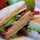 Amy's Triple Decker Turkey Bacon Sandwich - Layers of turkey bacon, Cheddar cheese, lettuce, tomato and mayo grace two slices of bread for this triple decker doozie. A wonderful sandwich at any time of the day.