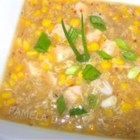 Chinese Creamy Corn Soup - Sherry and soy sauce are combined with chicken breast and a can of cream-style corn in this corn starch thickened soup to serve garnished with crumbled bacon.