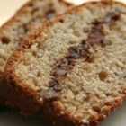 Creamy Banana Bread - A ribbon of pecan streusel runs through this rich cream cheese-banana bread.