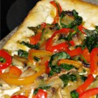 Tomatoless Pizza - This pizza is a baked version of a cream cheese summer pizza... packaged pizza dough, covered with a spread of cream cheese, sour cream and dill, topped with a skillet of onions, garlic, red pepper, baby spinach and mushrooms.