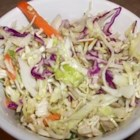 Asian Coleslaw Light - This Asian-style recipe coleslaw uses pre-packaged coleslaw mix and ramen noodles as well as an artificial sweetener in the dressing for a delicious alternative to the creamy summertime classic.