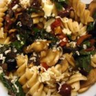 Mediterranean Pasta with Greens - A delicious blend of greens, olives, garlic, and sun-dried tomatoes tossed with pasta. Delicious and satisfying.