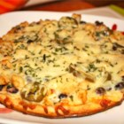 Black and White Pizza - This recipe is one that my boyfriend and I recreated from a dish at our favorite restaurant.  White chicken pizza with black beans and jalapenos. This pizza is made using already prepared ingredients which makes a fast, simple gourmet meal for two. Adjust the amount of each topping to your liking.