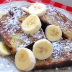 Banana Bread French Toast - This decadent breakfast treat is great way to start the day. It's so delicious you'll wish you could eat it every morning.