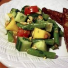 Thai-Inspired Confetti Salad - Light, a little sweet, crisp, and refreshing defines this salad combining chopped cucumbers, papaya, green beans, and a roma tomato with a zingy citrus dressing.