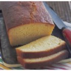 Zesty Lemon Loaf - This dressed-up pound cake-style lemon loaf has a delicate hint of ginger. The decadence of Grand Marnier makes this lemon loaf special. Great with Earl Grey tea or ice wine.