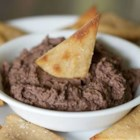 Clemons Family Bean Dip - This is a seriously cheesy and beefy bean dip! Grab a bag of your favorite tortilla chips and start dipping. Every time I make this recipe everyone waits to see who will take home the leftovers. It is even better the second day.