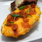 Twice Baked Potatoes II - This is a variation on baked potatoes that my parents taught me. If you love your potatoes with lots of sour cream and butter you'll love this one.