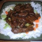 Spicy Orange Beef - Slivered orange zest, orange marmalade, and red pepper flakes add strong, hot citrus flavor to this stir-fry of round-steak strips. Steamed rice is a perfect accompaniment for this dish.
