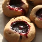 Sugared Black Raspberry Tea Cookies - Petite, crunchy, black raspberry filled thumbprints, dipped in granulated sugar, and studded with miniature chocolate chips. These cookies freeze well.