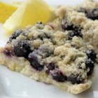Blueberry-Lemon Crumb Bars - Blueberry bars with a cookie crust and streusel topping. Rich in buttery goodness.