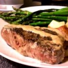 Filet Mignons With Pepper Cream Sauce - Delectable filet mignons get a coating of crushed peppercorns, then are cooked to perfect doneness and served with a velvety cream sauce to take the peppery bite down a notch.