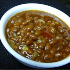 Better Baked Beans - Tangy, sweet old fashioned baked beans, are made the easy way in this side dish. This is my grandma's favorite semi home-made recipe. She makes it every Thanksgiving, and we usually end up scraping the pan clean! Never any leftovers!