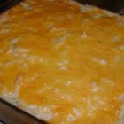 Potato Casserole III - Hash brown potatoes are combined with cream of potato soup, cream of celery soup, sour cream, onion and green bell pepper.  Parsley, paprika and shredded cheese add the finishing touches to this rich and creamy dish, which can be prepared a day in advanced and refrigerated.