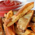 Baked French Fries I - Potato wedges baked with olive oil and flavored with the spices of garlic powder and paprika.