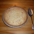 Pineapple Pie I -  Shredded coconut is sweetened and blended with eggs, a bit of flour, melted butter, and crushed pineapple. creamy sweet filling is then poured into a deep dish pastry shell and popped into the oven to bake for an hour. Cool and serve with freshly whipped cream and toasted coconut.