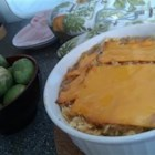 Tuna Casserole I - A baked tuna casserole layered with crushed potato chips, canned tuna, green peas, mushroom soup, and American cheese. A perfect family dish for a cool fall night!