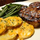 Grilled Brown Sugar Pork Chops - Grilled pork chops are basted with a sauce made with apple juice, brown sugar, and ginger.