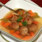 Chicken Meatball Soup - In this recipe, baked chicken meatballs and sauteed vegetables in chicken broth are served over a bed of cooked egg noodles.