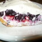 Blueberry Banana Pie - A no-bake cream cheese pie with sliced bananas, topped with blueberry pie filling and whipped cream.