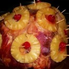 Pineapple Glaze for Ham - At long last, here are step-by-step instructions for making a classic and colorful pineapple-and- maraschino-cherry-festooned party ham, lusciously glazed with brown sugar and pineapple juice.