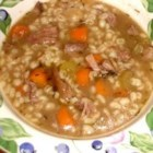 Beef and Barley Soup I - Meaty beef soup bones are combined with vegetables, a removable spice bag, barley and 12 cloves of garlic in this simple-to-prepare soup which needs 8 hours to cook in a slow cooker.