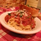 Bolognese Sauce with Meat - Prosciutto and ground beef give hearty flavor to a delicious simmer of roma tomatoes, garlic, onion and tomato paste. Add dollops of butter to the sauce for a rich finish.