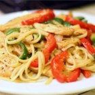 Cajun Chicken Pasta - Chicken dredged in Cajun spices is sauteed with bell peppers and mushrooms, and presented in a basil-cream sauce over linguine.