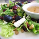 Deliciously Sweet Salad with Maple, Nuts, Seeds, Blueberries, and Goat Cheese - Maple syrup, dried cranberries, and blueberries add sweetness to this romaine-based salad with feta and goat cheese.