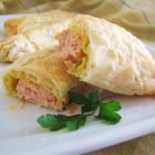 Wrapped Salmon - Savory salmon is seasoned with salt and pepper, coated with Dijon mustard, then wrapped in phyllo dough and baked. A simple and different way to serve salmon. Goes well with fresh steamed vegetables and rice.