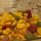 Corn O'Brien - Corn is cooked with bacon and bell pepper in this Irish-inspired side dish.