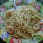 Garlic Shrimp Pasta - Use your microwave to make a butter and garlic sauce to coat tender strands of vermicelli and cooked shrimp. Sprinkle with Parmesan cheese and you have a quick and delicious main dish or appetizer.