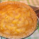 Peach Cream Pie I -   This is an open-faced peach pie that begs to be served with great spoonfuls of ice cream. Sliced peaches are piled into a prepared crust, slathered with a sweet buttery concoction, and baked until the crust browns and the peaches are tender and glistening.