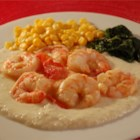 Lowcountry Shrimp and Cheese Grits - Succulent shrimp sauteed with diced tomato in olive oil and butter, served over garlic cheese grits.