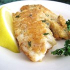 Almond-Crusted Tilapia - Tilapia is coated with ground almonds and Parmesan cheese in this delicious dish.