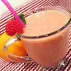 Sunshine Juice - This creamy but creamless raspberry-orange-banana juice makes a smooth and colorful start to the day.
