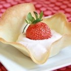 Cookie Tulips - Little fluttery, tender cookie bowls hold strawberry cream topped with fresh strawberries. It's such a pretty dessert, nobody will believe you made them yourself.