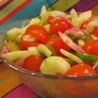 "Fire and Ice Salad - Cayenne pepper provides the  ""fire "" in this salad of tomatoes, peppers and onions marinated in a cooked dressing.  Sliced cucumbers provide the  ""ice "" as they are tossed into the salad just before serving."