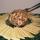 Cheese Ball - In this variation on a classic appetizer, two bricks of cream cheese are transformed into a slightly sweet spread for crackers by the addition of pineapple, green pepper and spices.