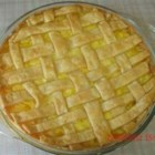Pineapple Pie IV - Fresh or canned, pineapple pieces are splashed with lemon juice, and blended with beaten eggs. This chunky and delicious filling is piled into a pastry crust, topped with a second crust, and baked in the oven until golden brown. Serve warm with French vanilla ice cream.