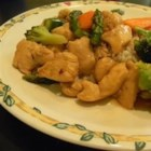 Orange Chicken Stir Fry - Chicken morsels are treated to a quick stir fry in a light, delectable orange-soy sauce and served over crispy chow mein noodles.