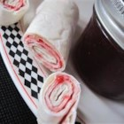Candy Wraps - This is a splendid recipe that is extremely tasty!  You don't really cook anything, so it is good for kids to make, but it is better if it can chill for about three and a half hours so the marmalade and syrup can seep into the tortilla so you get a sweeter and gooier product.  This simple recipe is tantalizingly gooey and sweet, so it can be used as a snack, part of a meal, or a dessert!