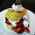 Summer Fruit Shortcakes - Celebrate summer with homemade buttermilk shortcakes topped with sweetened whipped cream and a fruity mix of blueberries, apricots, and cherries.