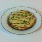 Sunday Morning Asian Frittata -  We think any morning would be just fine to serve this tasty frittata. Scallions, ginger, soy sauce and garlic spice up the cooked eggs. Then, bean sprouts and sesame seeds top off the egg mixture, and the skillet is put in the oven to bake. Just before s