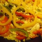Three Pepper Pilaf -  This colorful dish features red, green and yellow bell peppers with in turmeric-gold rice and scarlet tomatoes.  Beautiful to look at, even better to eat.