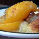 Peach Cobbler I - Fresh peaches are topped with bread, covered in a sweet butter sauce and baked.