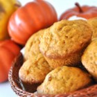 Pumpkin Wheat Honey Muffins - The goodness of whole wheat flour and pumpkin sweetened with honey.  Plump raisins and chopped walnuts add to the wholesome goodness of these muffins.  Good for breakfast, brunch or snack!